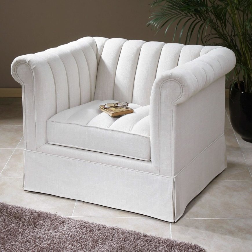 This beautiful white club chair features subtle roll arm design with vertical tufted cushioning. Discreet skirt hides the legs.