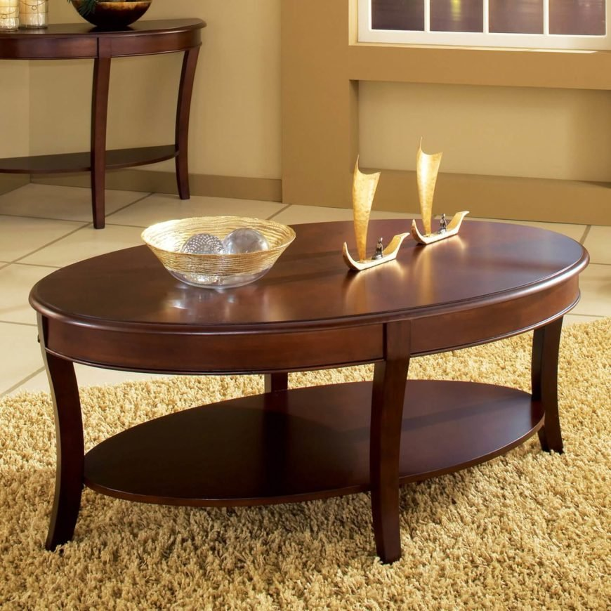 This ornate two-tier coffee table features intricate carving and sleek broad surfaces. The warm wood stain helps any room pop.
