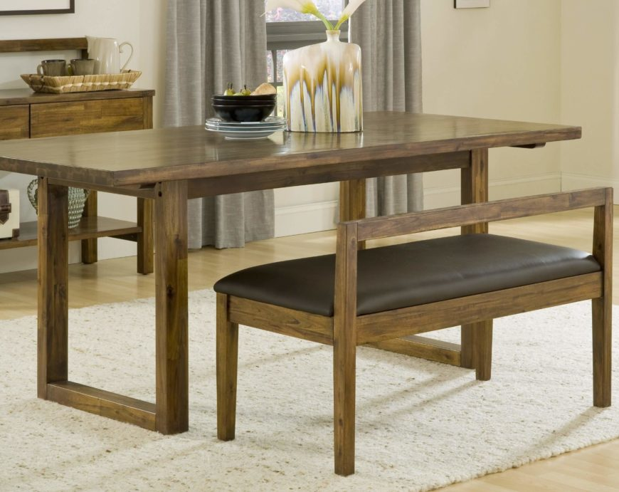 This rustic design wood dining table features a traditional structure, with unadorned legs and surface for a sleek, minimalist appearance. The old fashioned tone gives this table a timeless style.