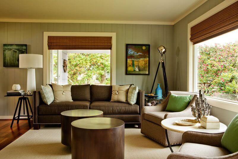 Living room in a neutral color palette with splashes of bold color.