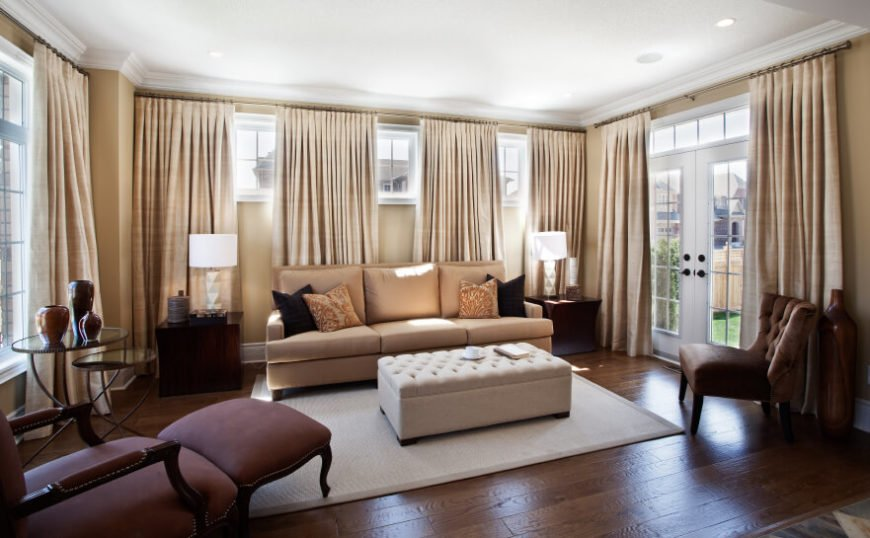 Simple beige curtains can take narrow, high windows and pull the eye down to the floor, adding height to the room.
