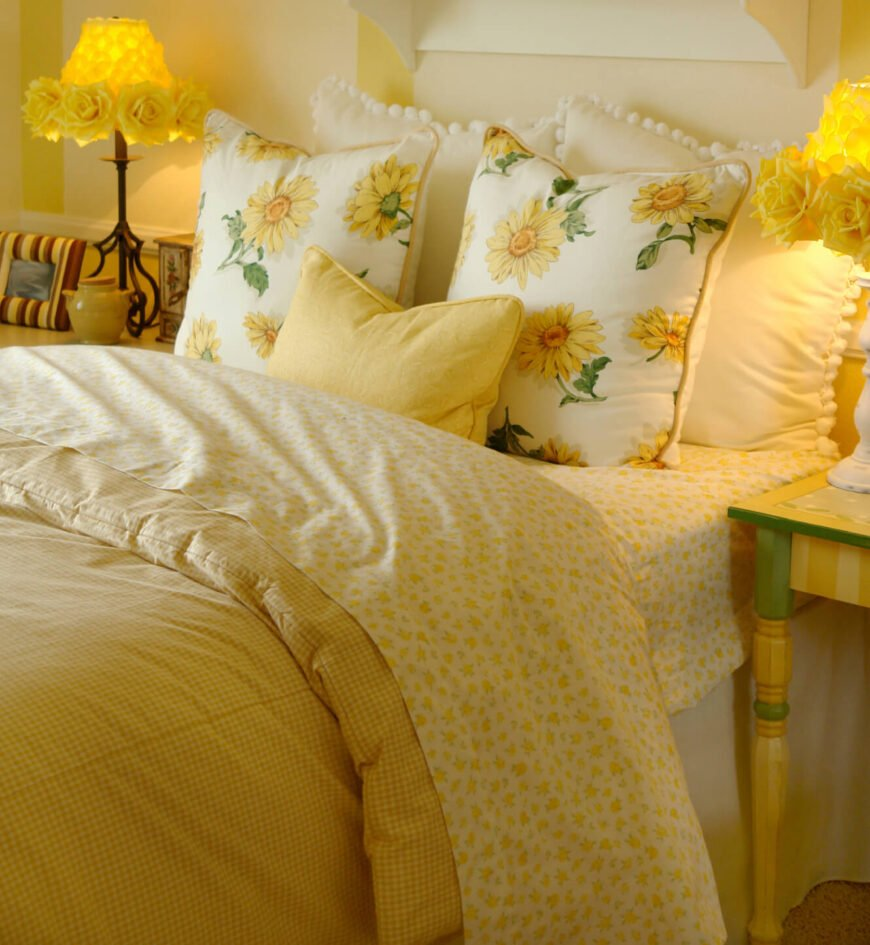 This bright, sunny yellow space is appealing and inviting. Mixing a variety of patterns in coordinating colors, this bedroom area is dynamic and interesting. Rose lampshades in vibrant yellow are a real standout in this lovely and relaxing room.