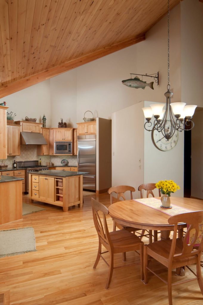 The white walls and similarly colored wood throughout this room allows the stainless steel appliances and accent counter tops to really pop.