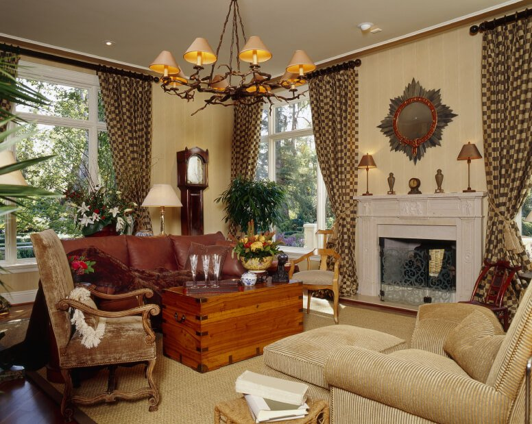 The eye-popping pattern of these brown and cream curtains contrast strongly with the textured solid furniture upholstery throughout the room. All the texture and patterns make for an eclectic design.