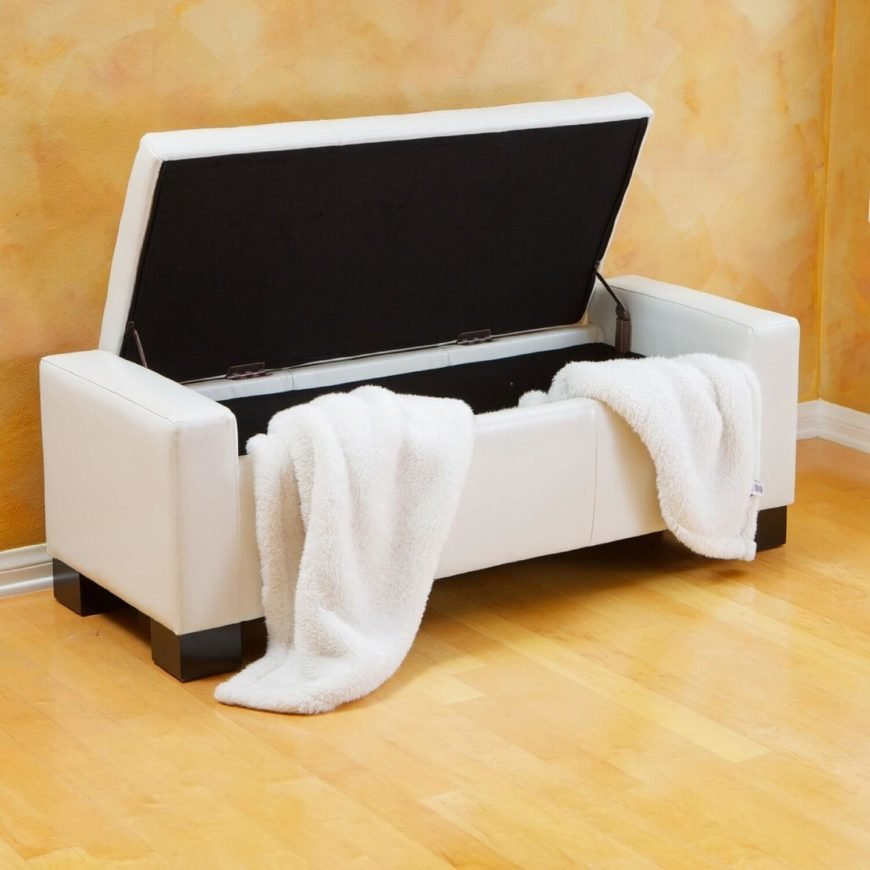 A leather ottoman with a tufted design and spacious storage. The elegant design is on raised feet, for easy vacuuming.