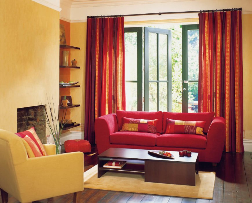 The light shining on these red curtains turns them almost gold-orange, adding an extra layer of dimension to this simple two-color design.