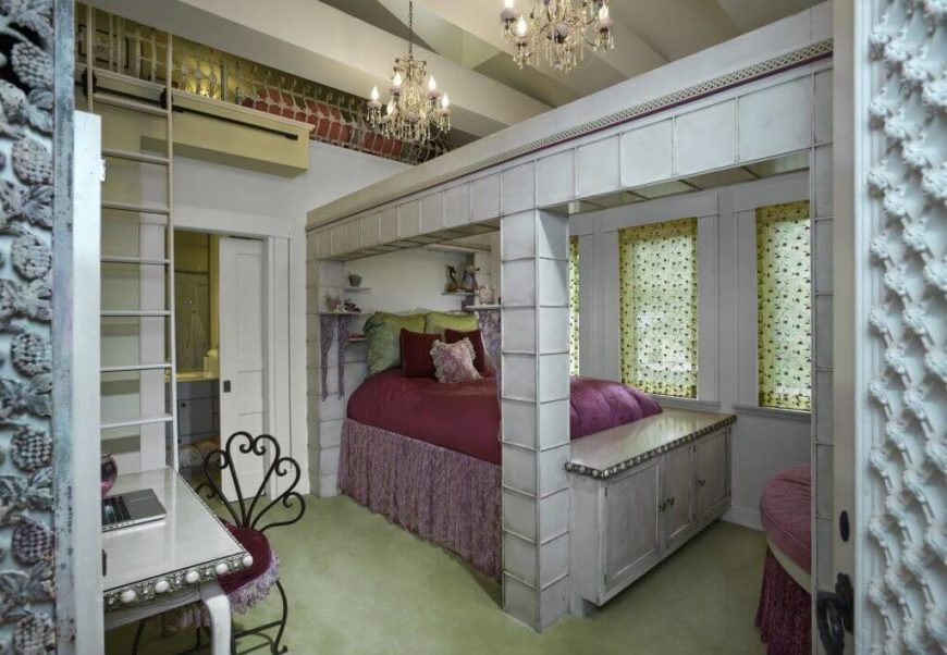 A unique girl's room with a bathroom suite. The layout of this room is custom built to create a loft above the bed that can be reached via a rolling bookcase ladder.