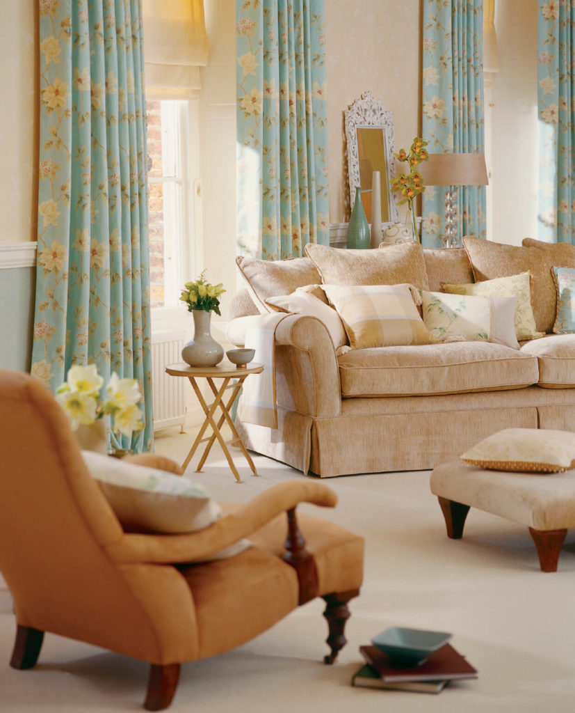 This living room is another great example of how colorful curtains can really brighten up a neutral space.
