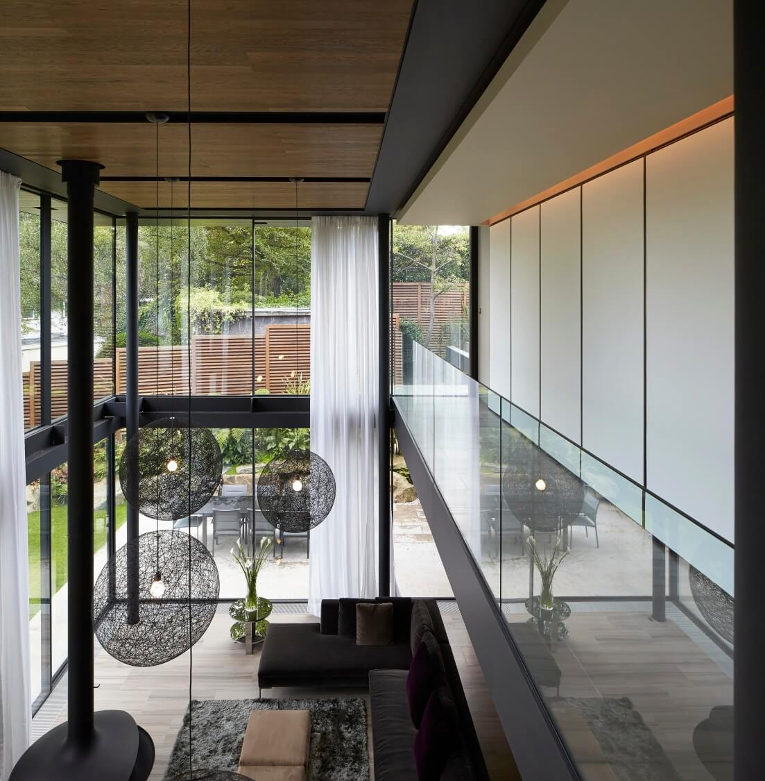 Here's the view from the study room down the length of the open-plan house, with the living room and adjacent patio in clear view.