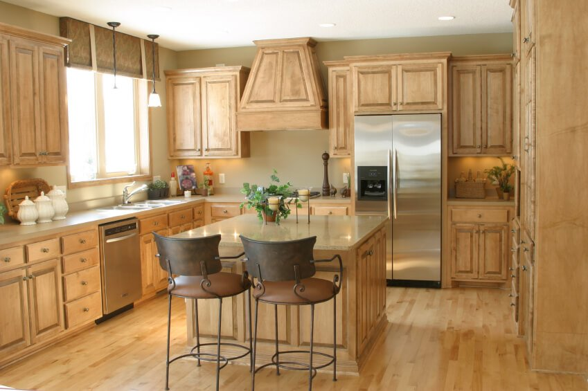 The lovely pale wood in this kitchen makes the room feel incredibly bright and open. The singular tone covers everything from the flooring on up, punctuated by stainless steel appliances.