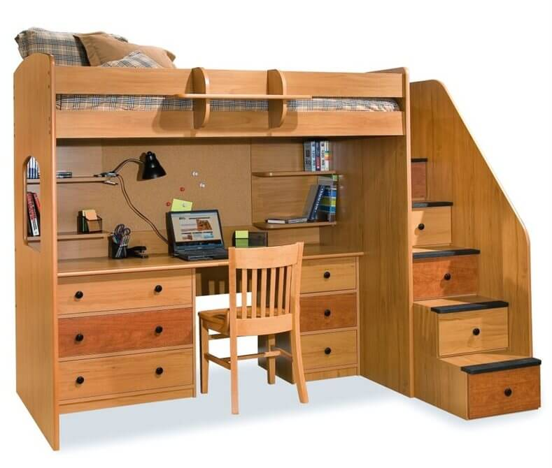 This elaborate setup centers on a large desk with abundant drawers flanking the seating space, plus slim shelving above. The stairs feature built-in drawers.