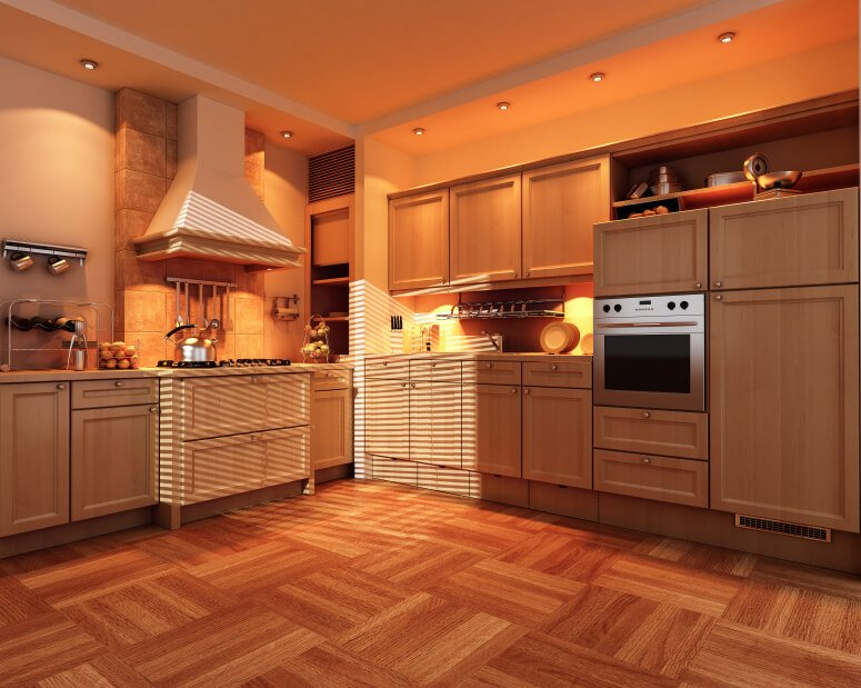 This beautiful parquet floor complements the warm colors of this kitchen, including the terra cotta backsplash and toasty lighting. The addition of stainless steel appliances adds a cooling touch.