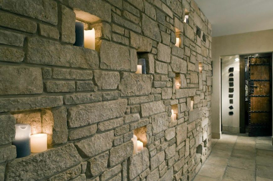 Down the hallway is the amazing stone wall with built-in alcoves that are lit by pillar candles. This wall, so close to the entrance, sets the atmosphere for the rest of the home.