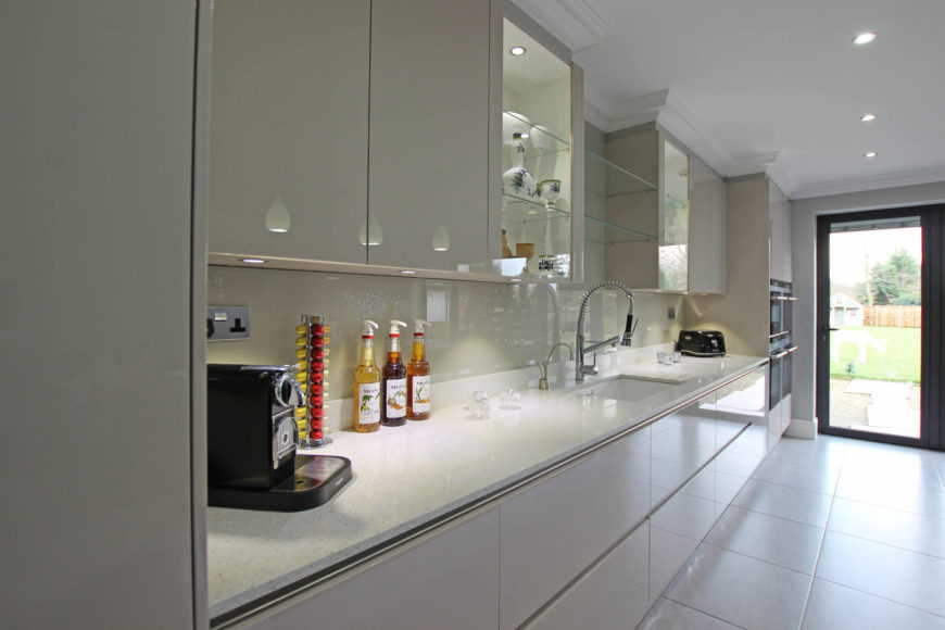 Here we see the perfectly symmetrical countertop and cabinetry setup, with large sink at center.