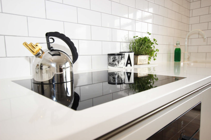 A close look at the countertop reveals intricate seams and a great match for the ultra-modern appliances.