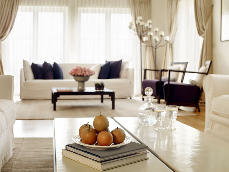 Sheer curtains below side panels allow you to keep the look of your drapes while not having to constantly tie back your heavier curtains.