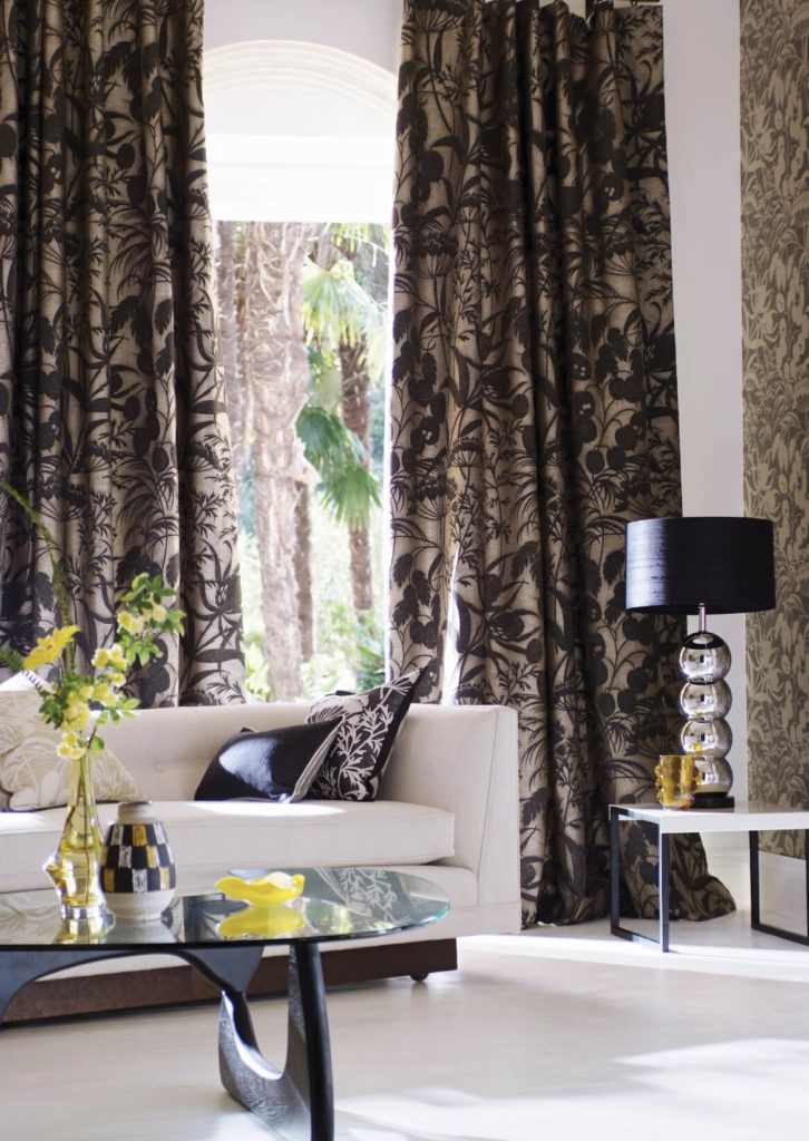 A heavy pattern in your curtains can easily be balanced by a lighter solid in the walls floor, or sofa.