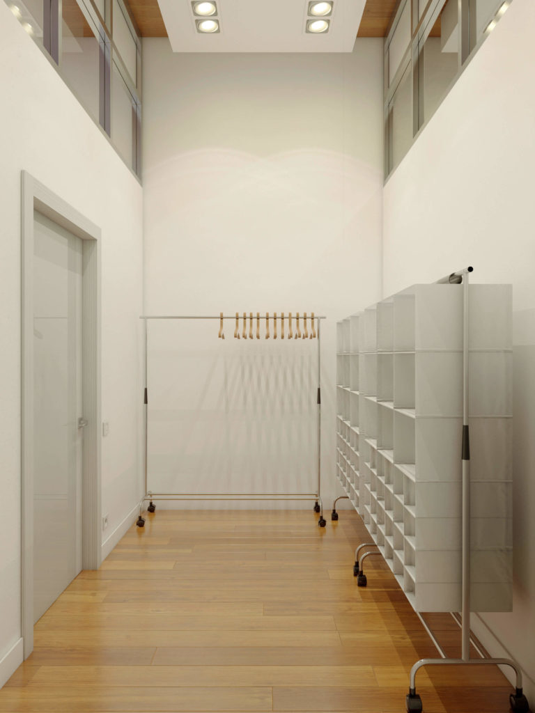Between rooms we have this immense storage space, with portable shelving courtesy of wheeled metal racks.