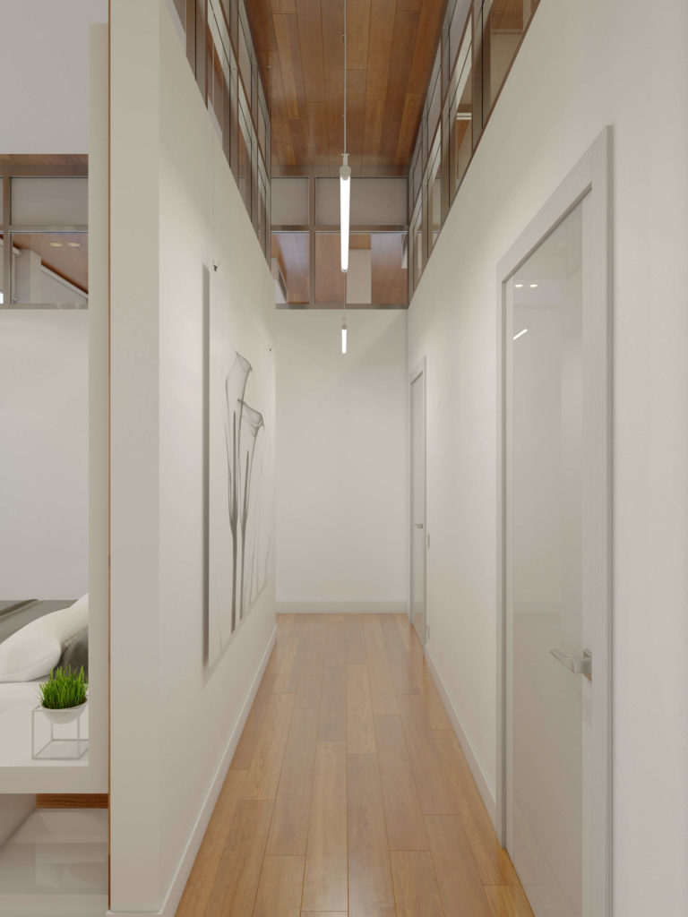 The upper level windows allow for every high-ceiling space within the home to feel connected and open, including the lengthy hallway.