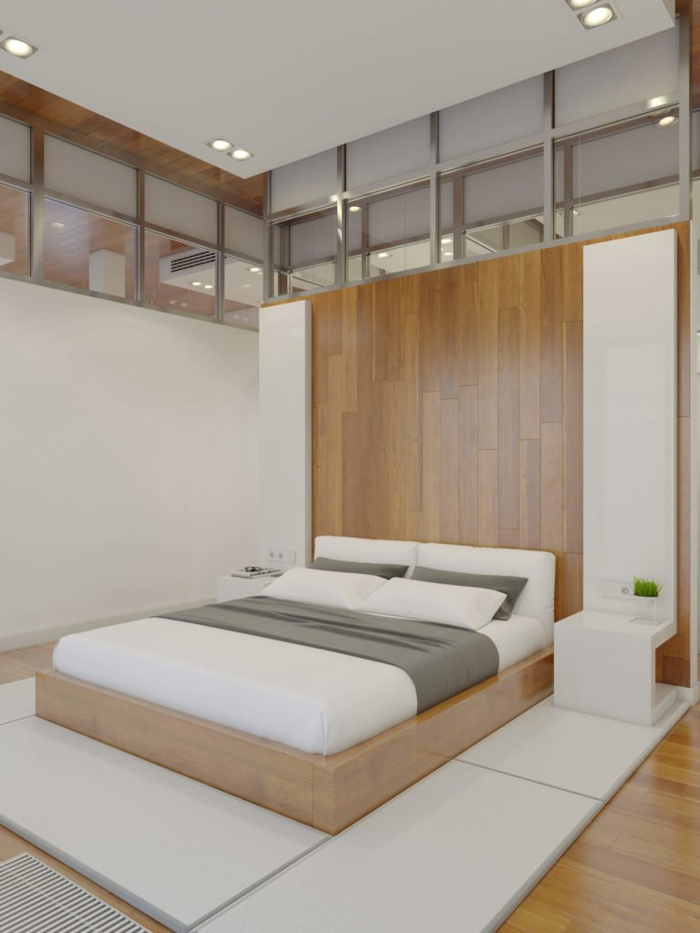 A pair of sleek white panels on the rich wood dividing wall double as bedside tables.
