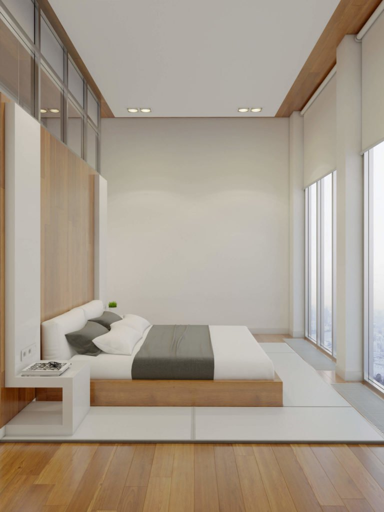The bed faces a pair of full height window sets, creating a vastly opened visual space for the primary bedroom.