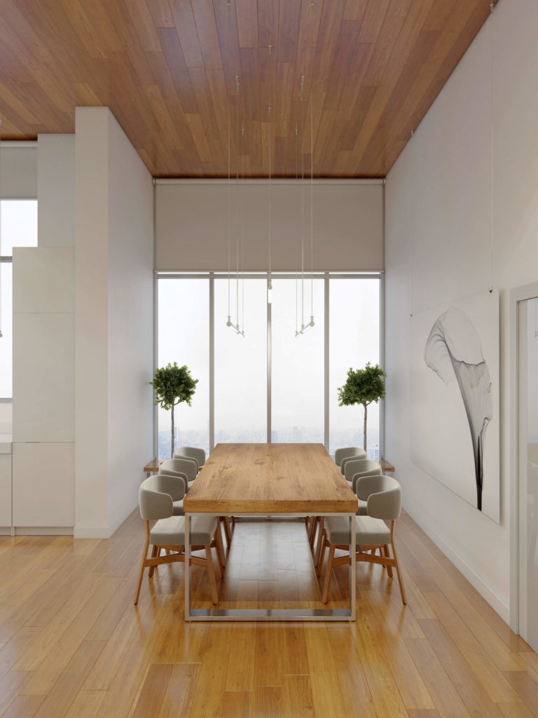 The table, with thick slab hardwood top and polished metal frame, stands before another set of full-height windows, with a massive black and white art print on wall to the right.