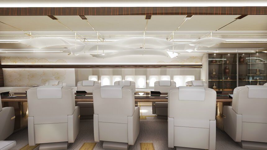 Here we see the large boardroom component of the aerial home, which doubles as a formal dining room that seats up to 12 people. The massive table at center offers a rich dark counterpoint to the sleek white, cream, and gold surroundings. A unique diffuse light feature hangs above the table in white, adding a visual anchor to the space.