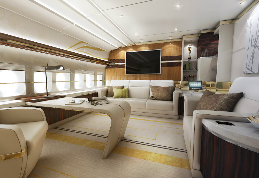 Here we have the large office, replete with ultra-modern desk built into the structure, abundant cream leather seating options, and a bold mixture of gold and dark wood tones. Recessed lighting allows for unobtrusive visuals, while a lengthy countertop sits below the windows at left.