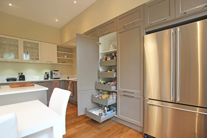 With the large cupboard door open, we see a hint of the vast array of efficient storage built into this kitchen.