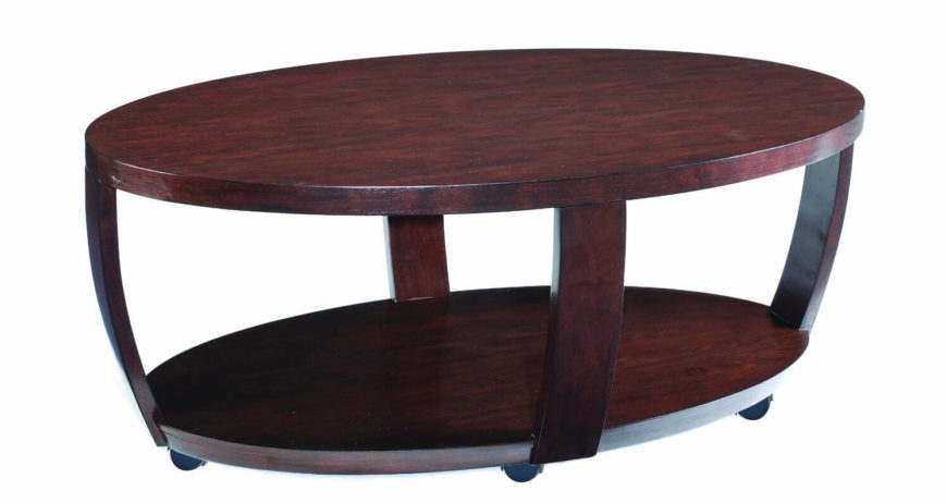 This rich hued coffee table stands on a set of dark casters for mobility. The unique shape bulges out on curved frame pieces from a smaller lower tier.