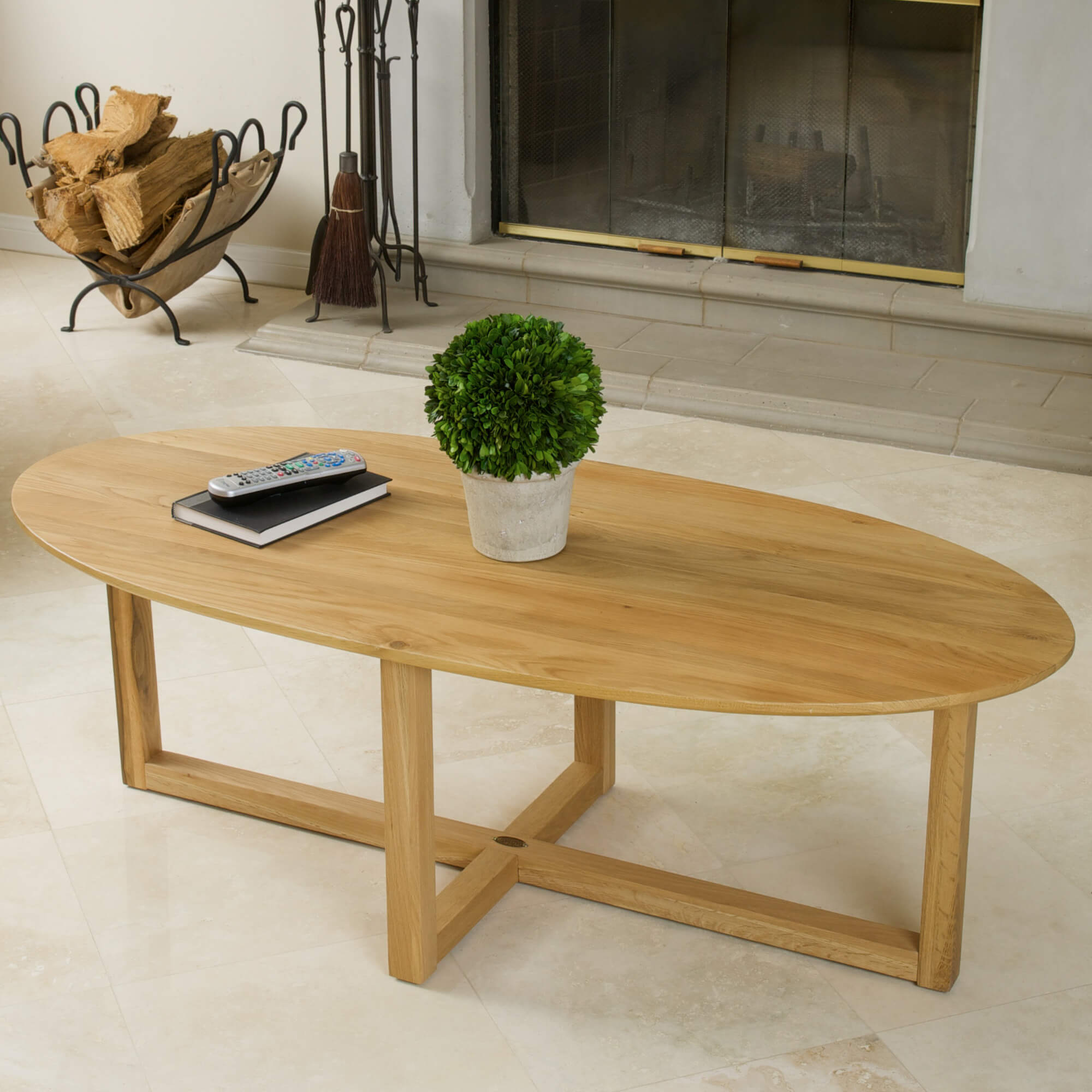 Here's a coffee table boasting light and bright natural wood tones. The wide, surf board shape is perfect for standing in front of lengthy sofas, and the bright color looks fantastic in lighter rooms.