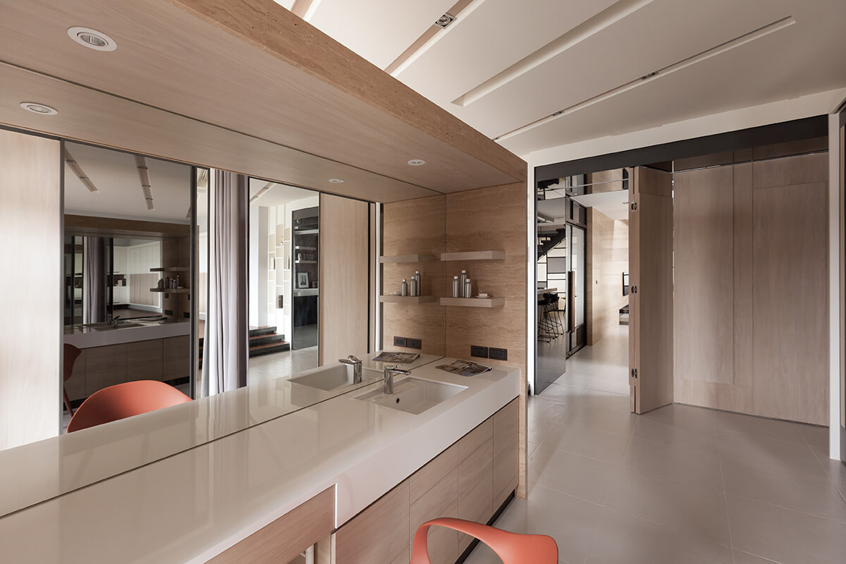 The bathroom half of the en suite involves marble, sleek white vanity countertop, and abundant storage options.