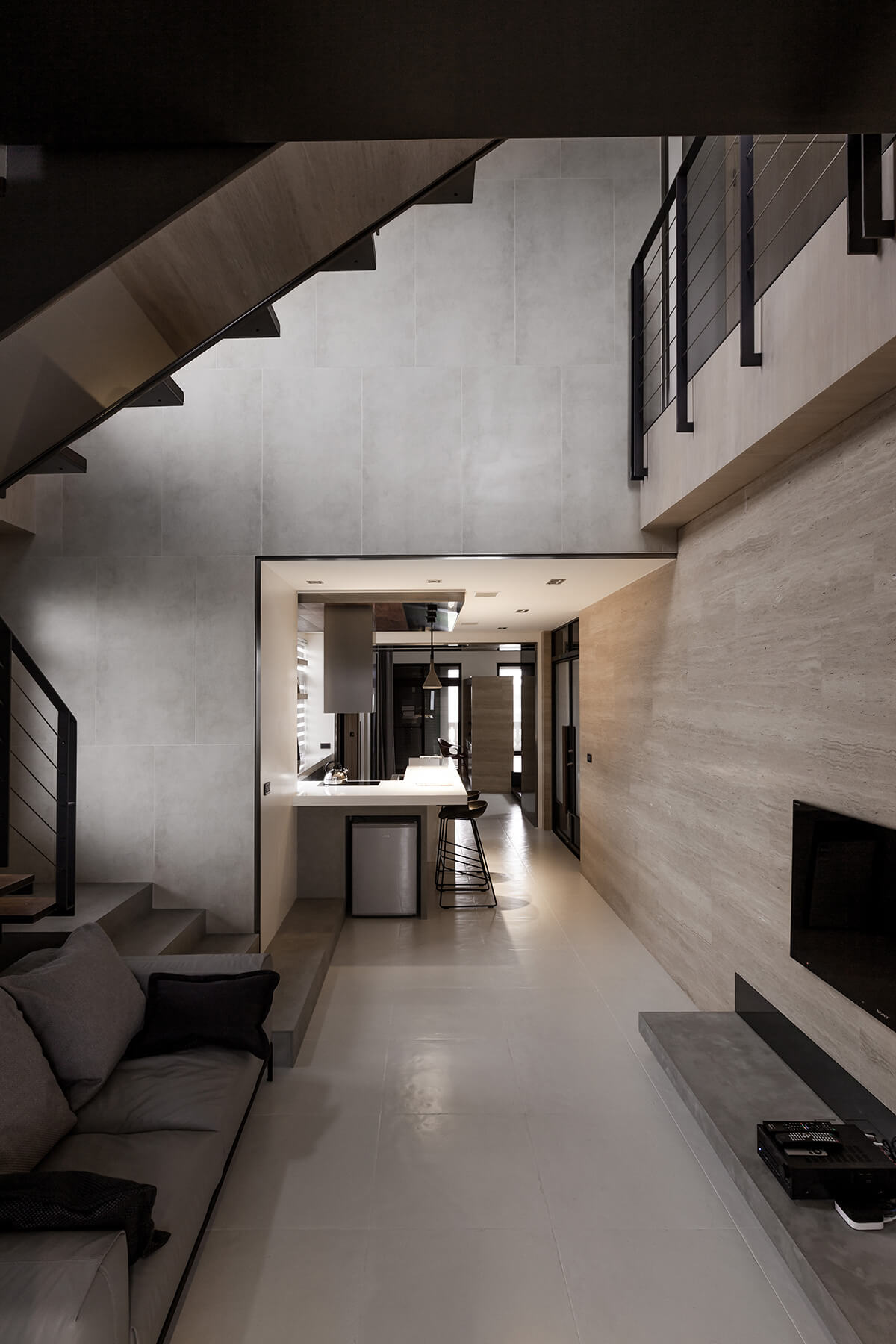 With a head-on view, we see the cozier, lower-ceiling space carved out of the immense structural wall.