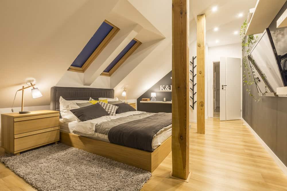 Stunning master bedroom in attic with skylights, new wood flooring and recessed lighting.