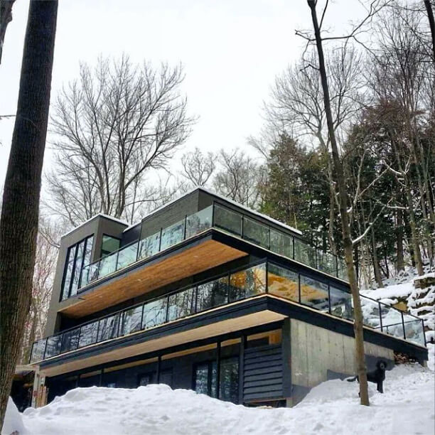 Finally, we see the home in winter, ensconced in snow. The bright surroundings only serve to better highlight the unique structure.