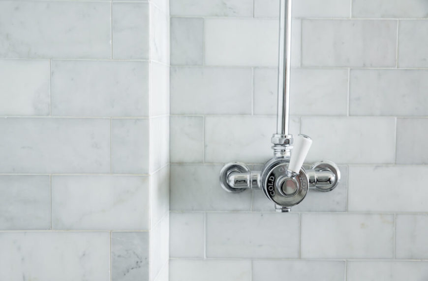 Rich marble tiling adorns the bathroom.
