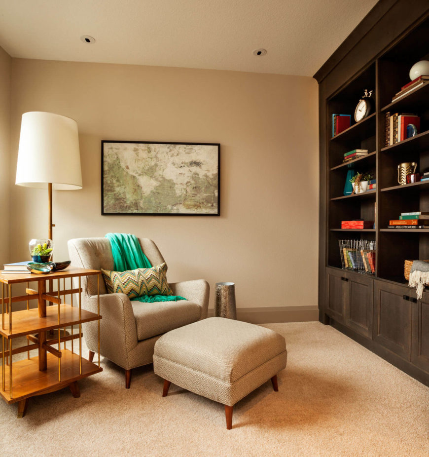 A reading room with built in bookcases and a tall side table with plenty of space for books in progress.