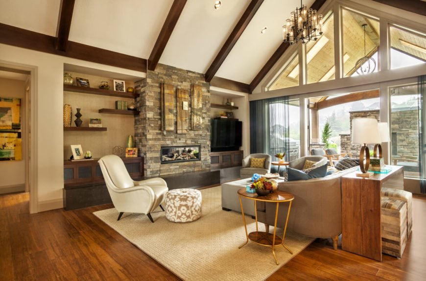 Spacious living room with exposed wood beams and expansive windows.