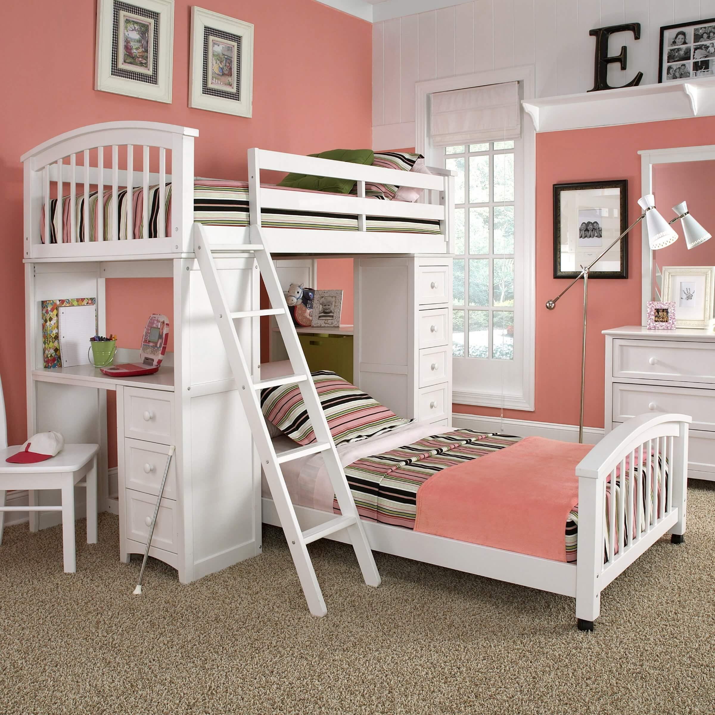This bold whit ebed features a perpendicularly mounted lower bunk on casters for portability and placement options. The desk at left is complemented by shelving and drawers at right.