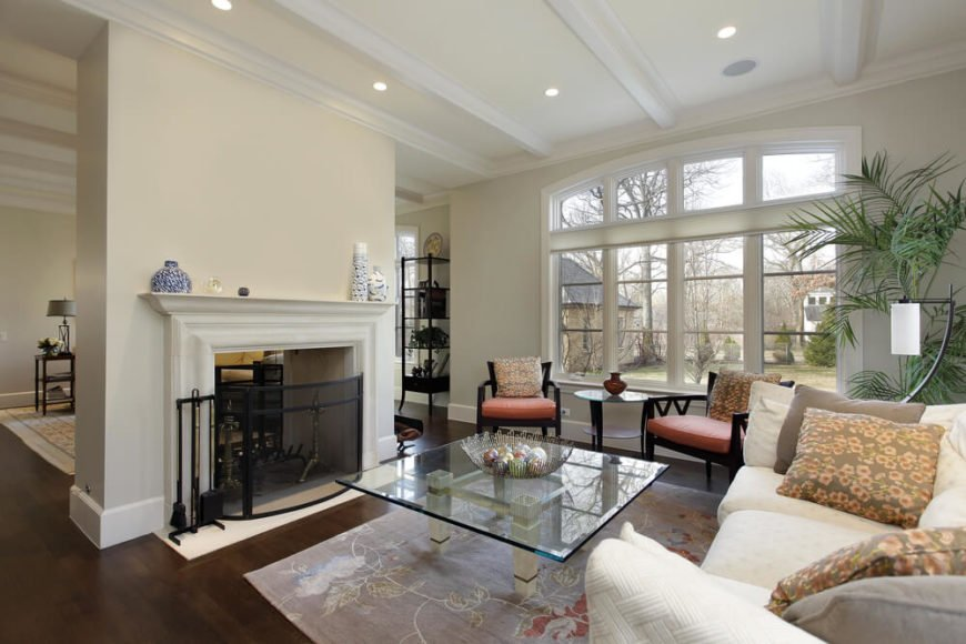 Contemporary dual-sided living room with dark hardwood floors.