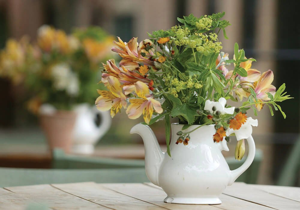 Lilies in a white teapot