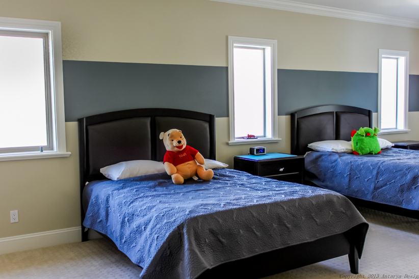 Moving to the upstairs, the children's bedroom is less showy, but no less comfortable than the rest of the home. This room focuses more on function, providing beds that will be large enough for the owner's children to grow up in.