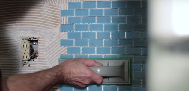 """Use your rubber float to """"tamp"""" the tile into the adhesive securely and evenly."""