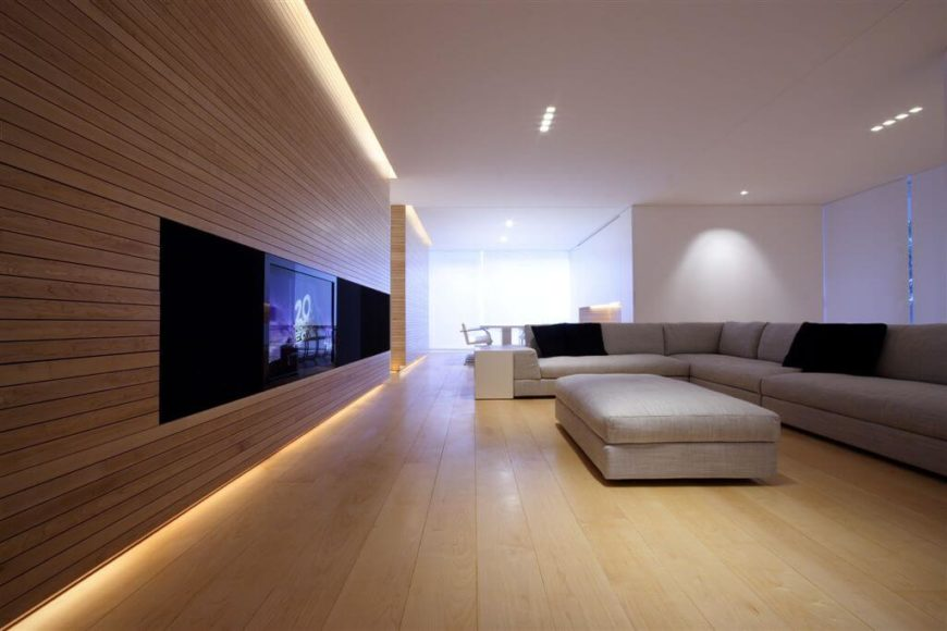 This open floor plan features a lot of hidden lights. The fair colored hardwood floors allow the soft glow of the lights to accent the natural wood throughout home.