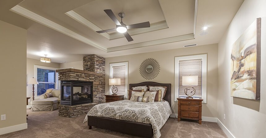 This bedroom is separated into two distinct areas by the stone fireplace. The screened-in hearth is dual sided and can be viewed from the sitting room on the opposite side.