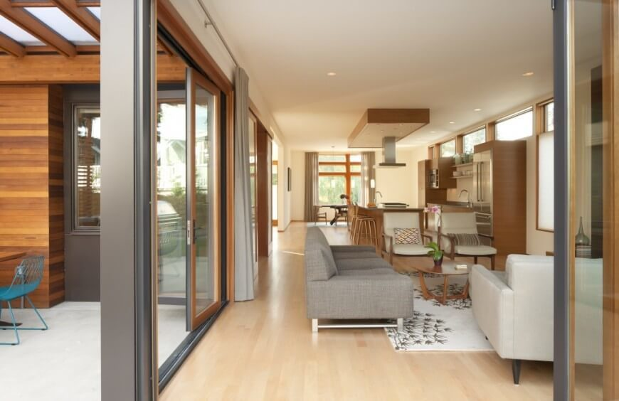 This summer home is breezy and full of sunlight. The light color of the floor and walls makes the room feel bright and inviting.