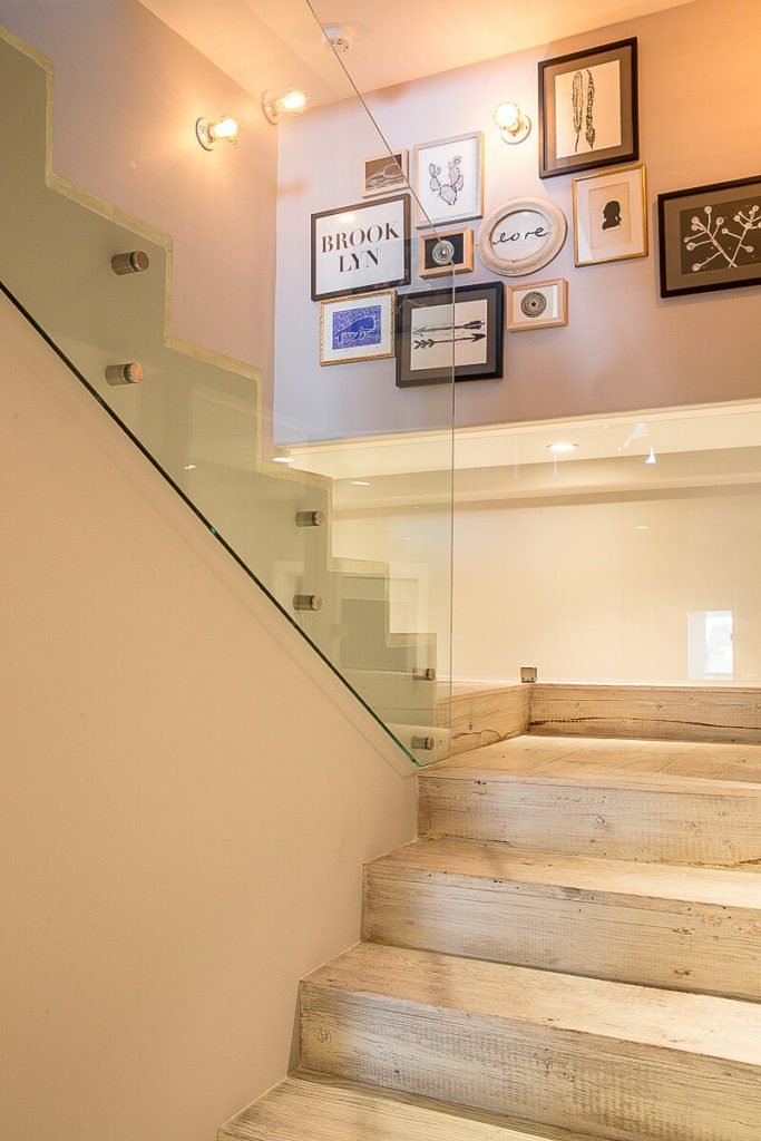 As we move to the upstairs, we fall back into the modern design, although the natural light hardwood continues up the steps.