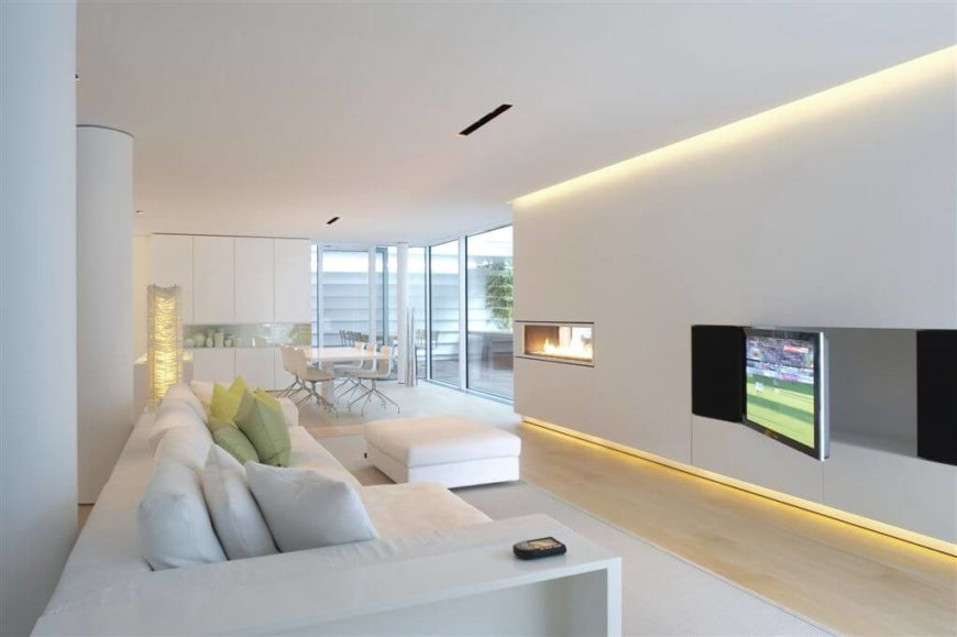 This home has a pale color-scheme from the floor to the ceiling. The glow of the amber lights continues the contemporary hues throughout the home.