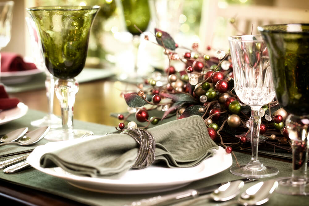 Another festive table setting in evergreen and gray. The napkin ring is rimmed in shimmering crystals.