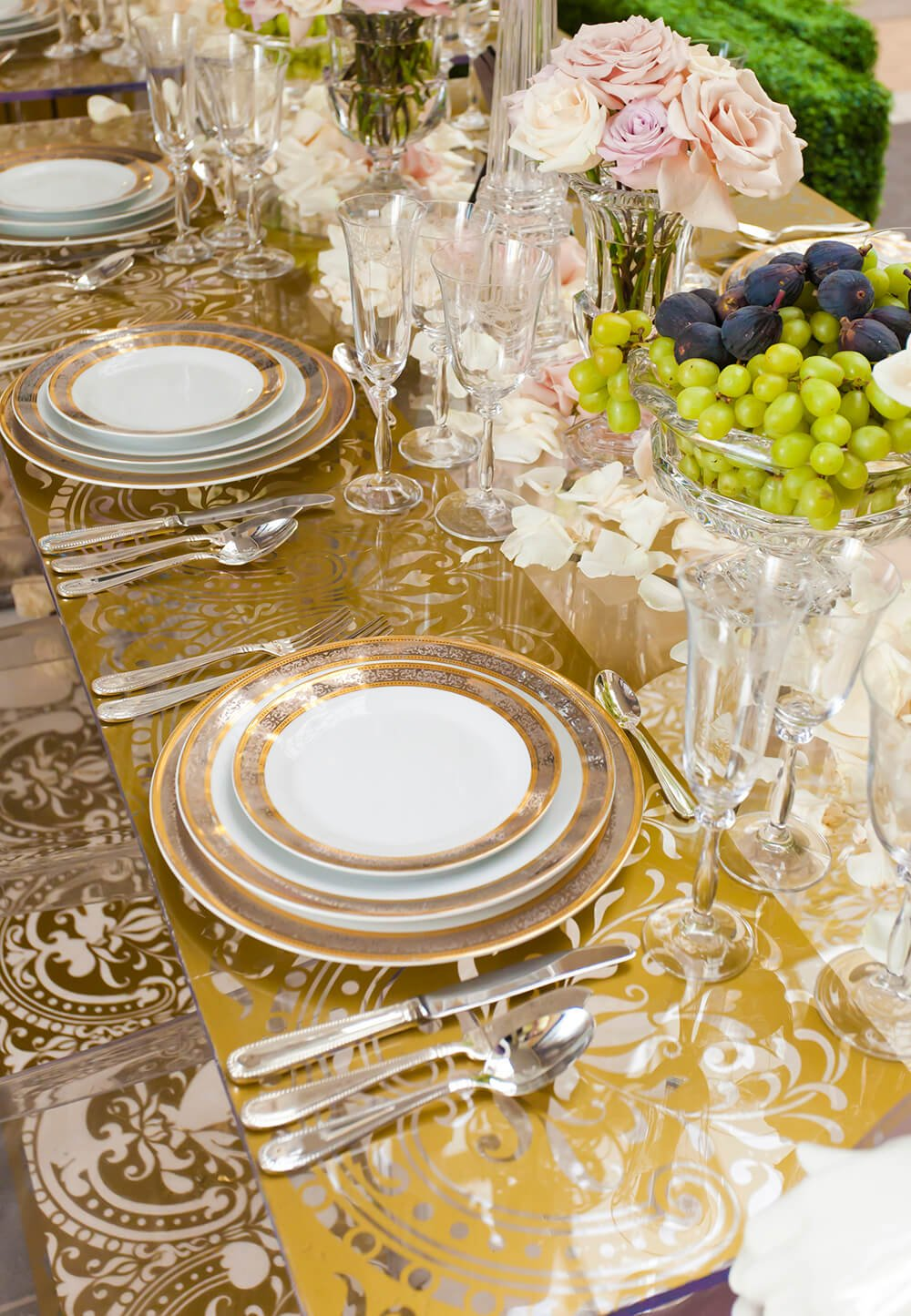 The exquisite details on the plates, combined with the pattern of the table makes for an unforgettable dining experience.